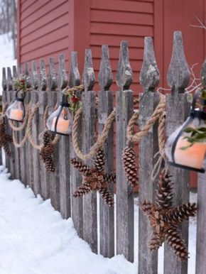 Heavy duty rope with lanterns and pinecones wired into star shapes instead of garland | Living the Country Life