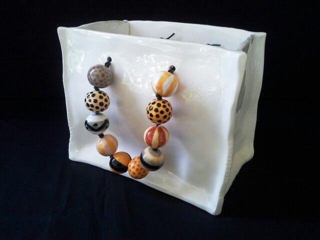 DIANE KOTZAMANIS....African colours inspired ceramic bag....visit facebook page..... https://m.facebook.com/pages/DK-Ceramics/476698149067003 ...