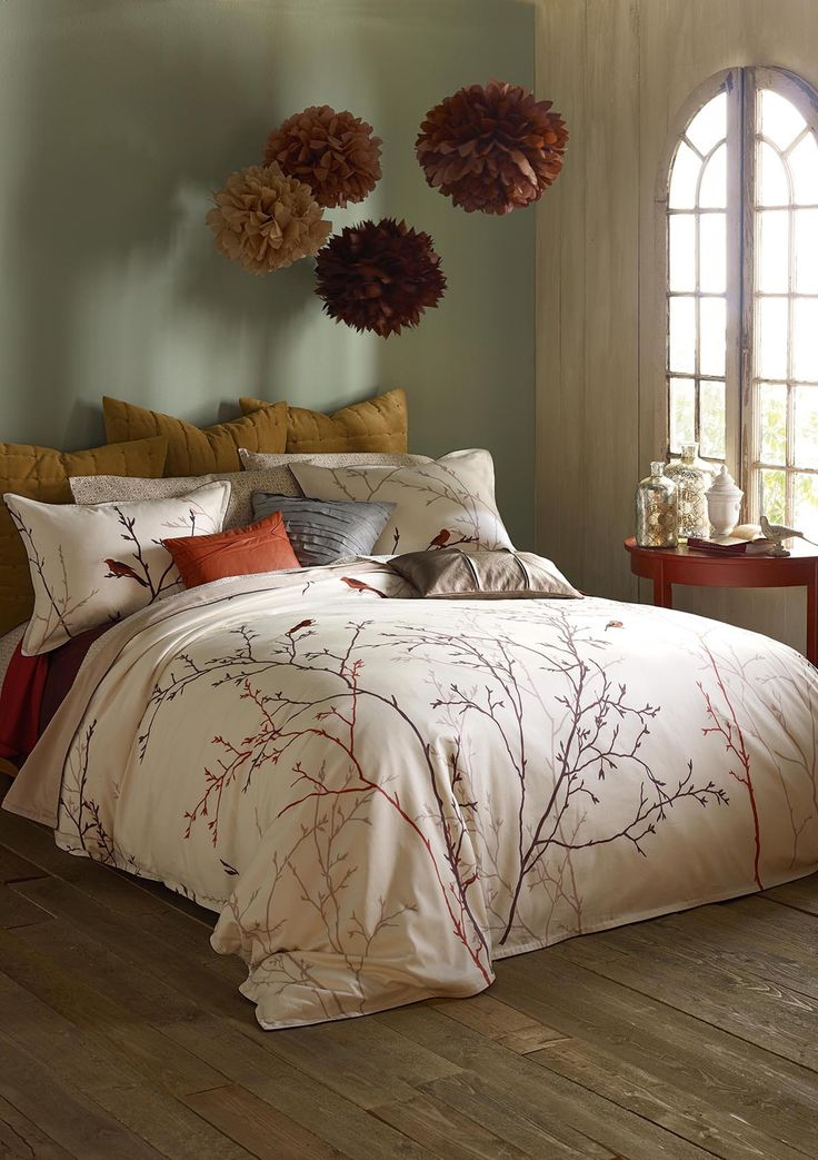 The burgundies add a romantic autumn feel to this rustic for Rustic romantic bedroom