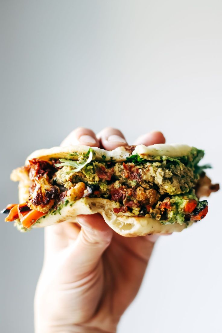 Naan-wich: 5 ingredient falafel, roasted veggies, and avocado sauce stuffed between pillowy garlic naan.