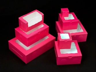 @Gretchen A Pink bakery boxes. This site has a variety-- with windows or just solid.