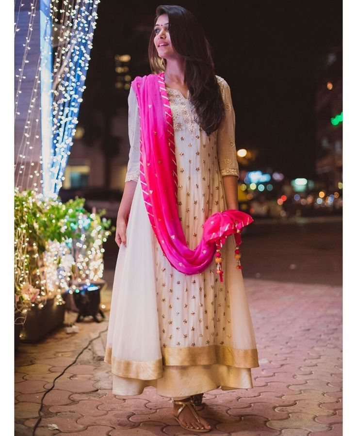White Anarkali with golden work in b/w and a pink dupatta