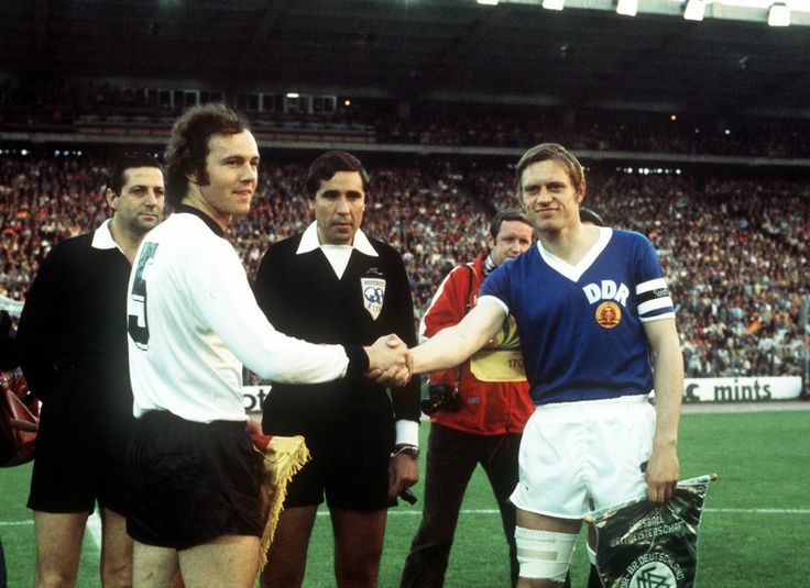 West Germany captain Franz Beckenbauer and East Germany captain Bernd Bransch ahead of their group stage match in Hamburg's Volksparkstadion at the 1974 World Cup match. East Germany won the match 1-0.
