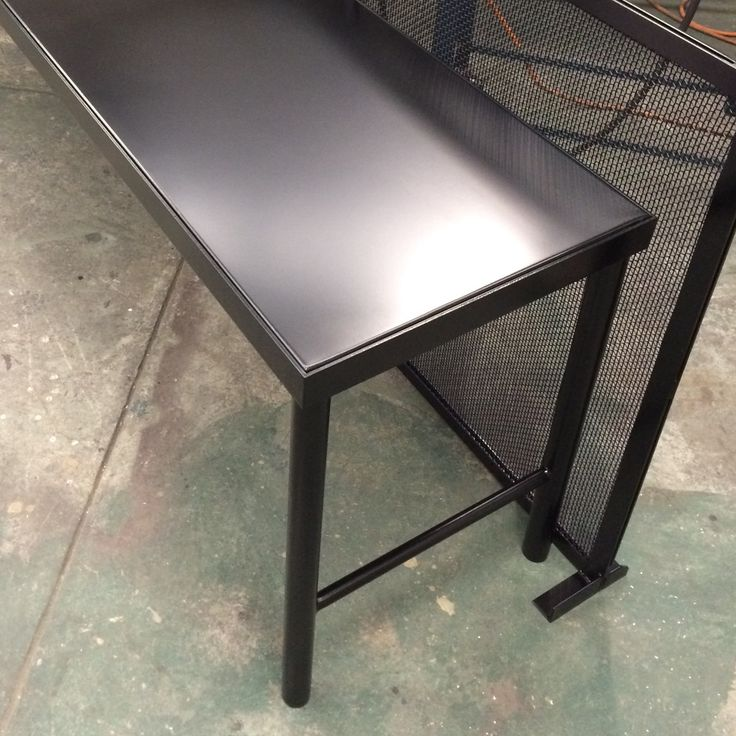 Custom outdoor tables and screens. Zincalume tops, steel frame and woven mesh screens all powder coated black.