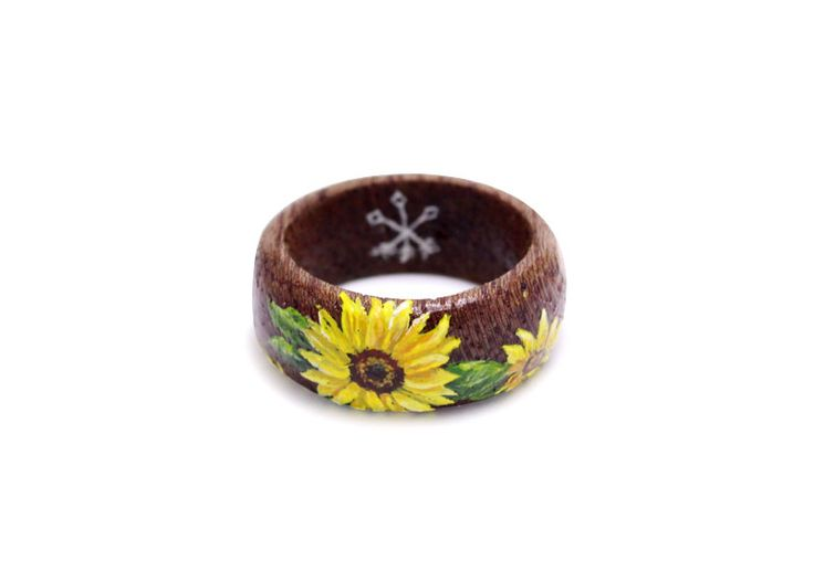 Hand painted sunflower on wooden ring by Huntress & Hunter. Limited edition miniature wearable art pieces.