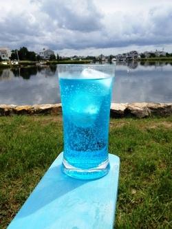 Hard Ocean Water:  1.5 ounces Skyy Infusions Coconut Vodka,  1 ounce Blue Curacao liquor,  Sprite