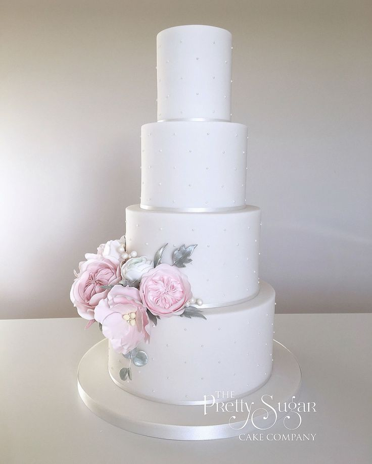 Piped pearls wedding cake with palest pink sugar peonies and garden roses