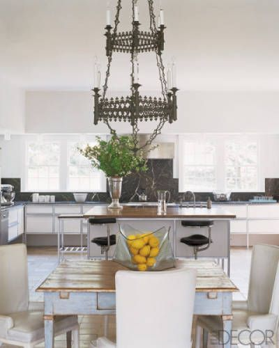 In a Lou Marotta designed West Cornwall, Connecticut, country house, a neo-Gothic English bronze chandelier hangs above an 18th-century Italian farm table.