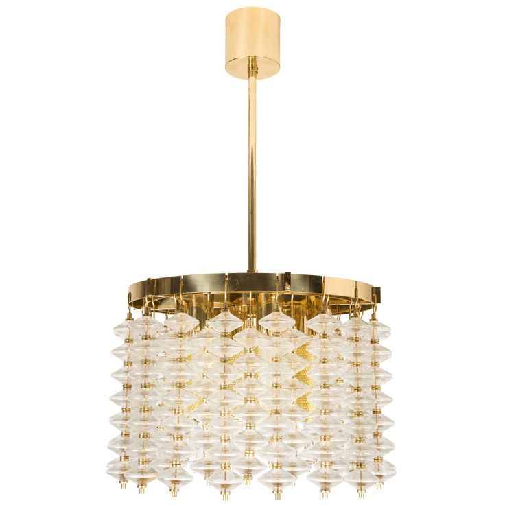 Brass and glass chandelier with perforated diffusers designed for markaryd