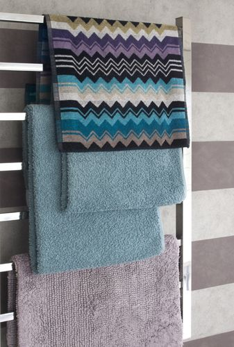 Using coloured towels and patterned wallpaper to put personality into a bathroom. Missoni mixed with plain colours #missoni #bathrooms #towels #interiors #interiordesigner #design #wallpaper