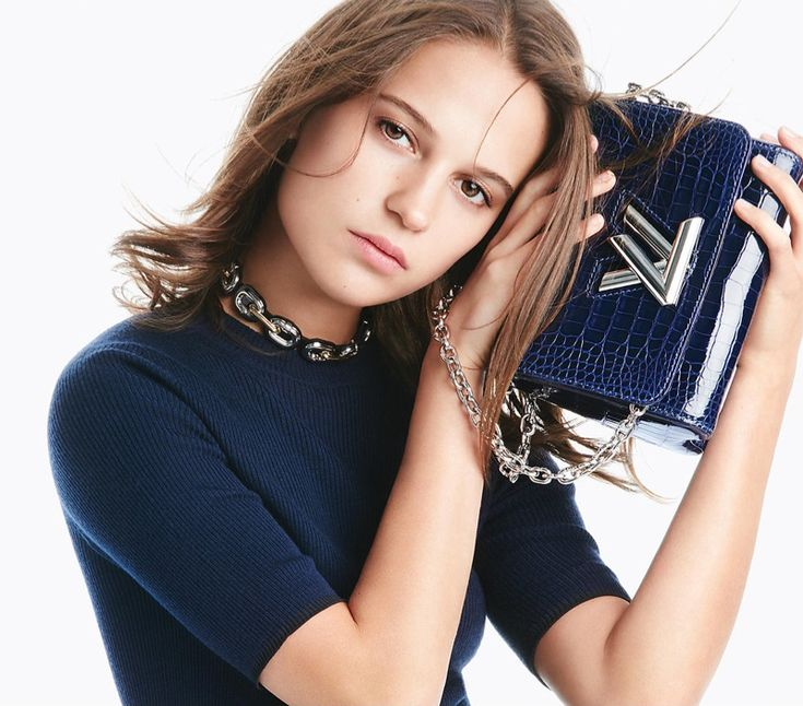 Alicia Vikander poses with Louis Vuitton Twist bag with a knitwear top for 2016 campaign
