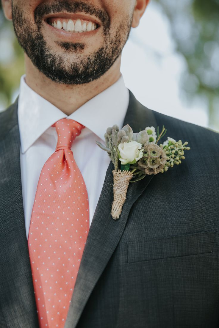 Groom Boutonniere. White Spray Rose, Seeded Eucalyptus, Succulent, Wax Flower, and Scabvious Pods. Jenny Smith & Co.