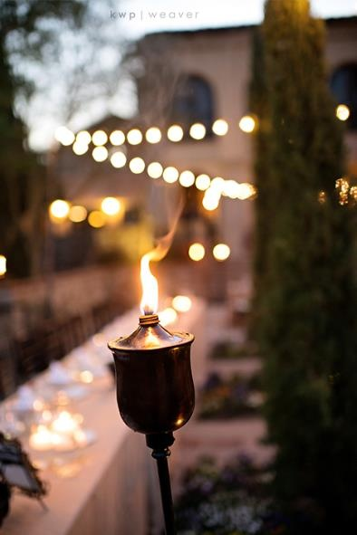 Flaming torches for outdoor wedding lighting.