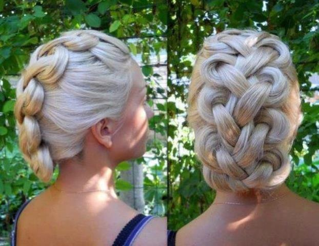 *from Modern Salon  Difficult but beautiful!  at the bottom it is tucked under. this is considered reverse french braid.