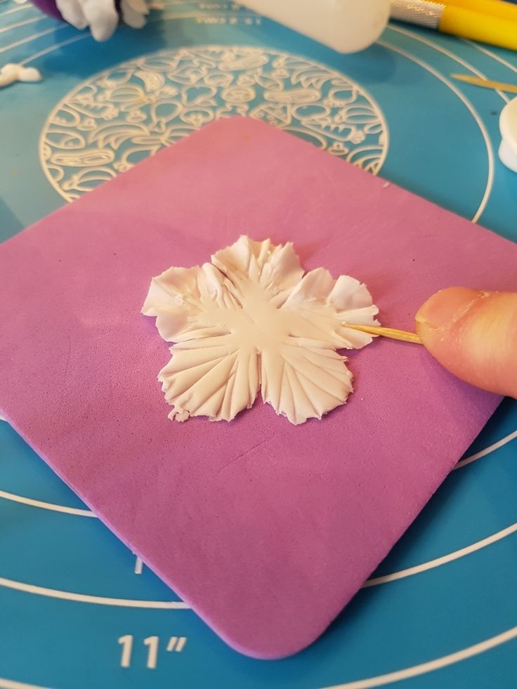 3. Ruffle edges of petals using cocktail stick on a flower forming foam