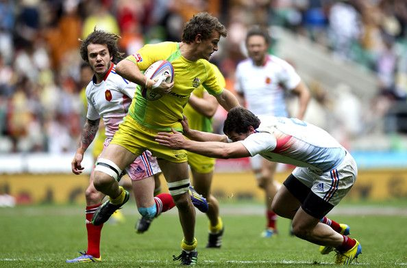 Nick Edwards of Australia is tackled by Steeve Barry of France during the Marriott London Sevens - Day One at Twickenham on May 11, 2013 in London, England.