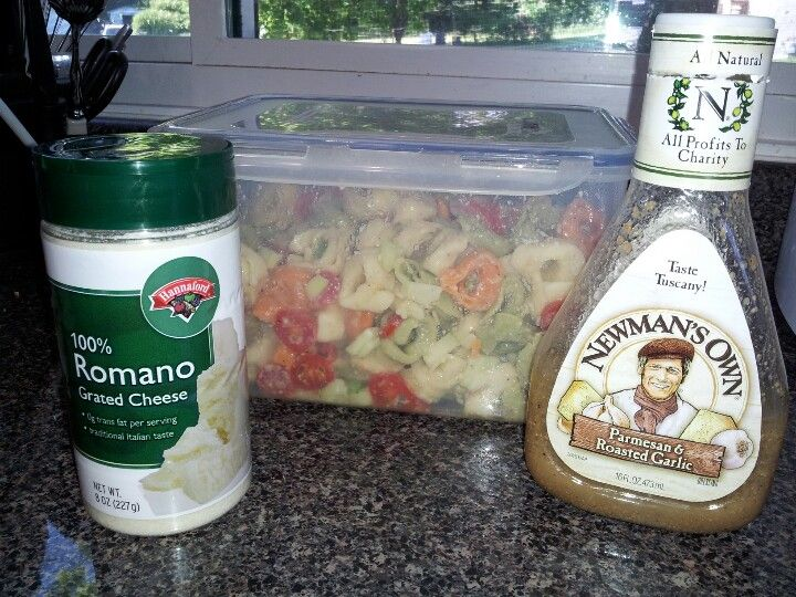 Cold tortellini salad- 3 bags tri-color tortellini, sliced cherry tomatoes, cucumber, green pepper, romano cheese, Newmans parmesan & roasted garlic salad dressing