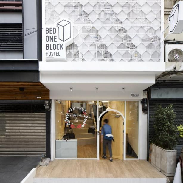 Bed One Block Hostel Design - Entrance.  This slimlined hostel design in Bangkok, Thailand is genius! You can not not smile being greeted by that hobbit hole door!