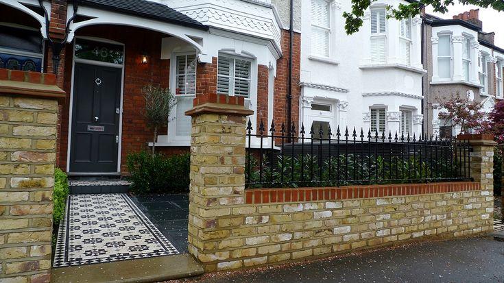 Yorkstone entrance stone victorian mosaic tile path yellow brick garden wall with metal rail slate paving planting London