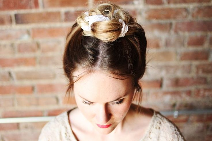 Pull hair into a high pony tail at the top  of your head. Wrap a piece of lace around the pony tail and twist into a loose bun. Pin in place and style any loose strands of hair. Pretty lace top bun- yes, please!