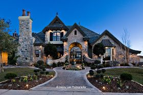 Copper accent. Arched entrance. Upstairs bedroom balcony. Stone. Stucco. It house