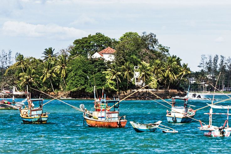 Fishing boats in the water surrounding Taprobane Island in Weligama, Sri Lanka. Photo by: David Crookes