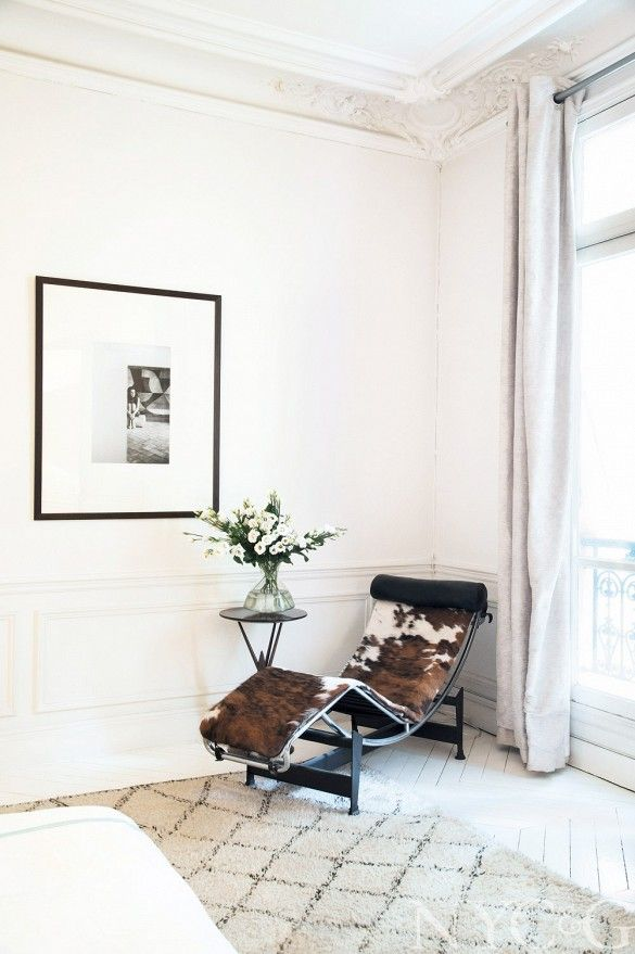 Seating corner with Le Corbusier LC4 cowhide chaise lounge chair and Moroccan rug.
