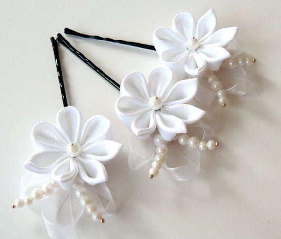 This listing is for 3 small handmade fabric flower hair pins in white. The flowers are made in the technique of tsumami kanzashi from grosgrain ribbon.