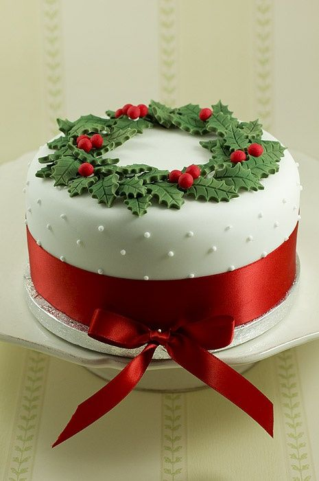classy christmas cake ~ Wreath cake    Why do I post these things?  The closest Ill get is taking the picture to the bakery :)