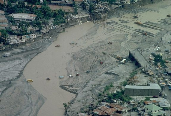 Widened RiverCredit: USGSCars and people traverse the flooded river after mudflows wiped out the bridges after the Pinatubo eruption in June 1991.