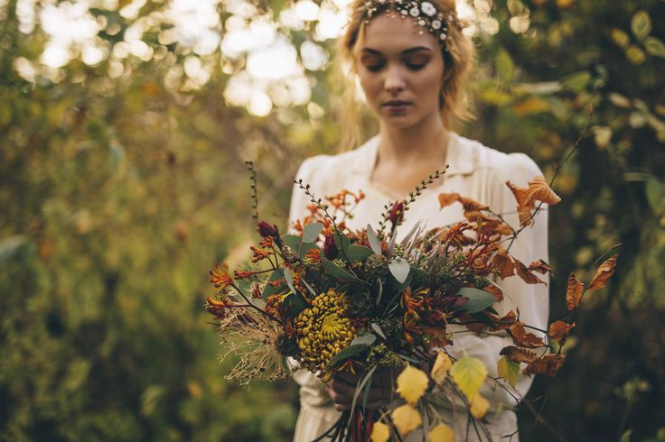 Wild Autumn bride bouquet in rust, orange and yellow.  Captured by Shelley Richmond Photography