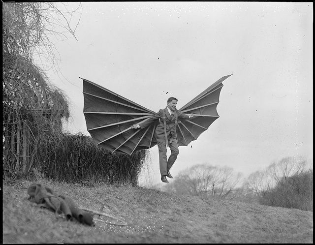 Demonstration with Mme. Alberti's flying contraption, 1931. Courtesy of the Boston Public Library, Leslie Jones Collection.: Alberti Flying, Bats, Funny Commercial, Batman, Sports Coats, Public Libraries, Vintage Photo, Vintage Image, Flying Contrapt