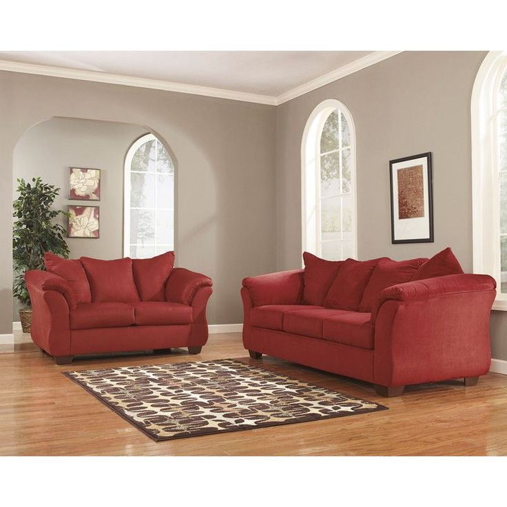 With the exciting contemporary style of the sweeping padded arms and plush pillow back design, the sleek beauty of the ''Darcy-Salsa'' upholstery collection is sure to awaken the decor of any home env