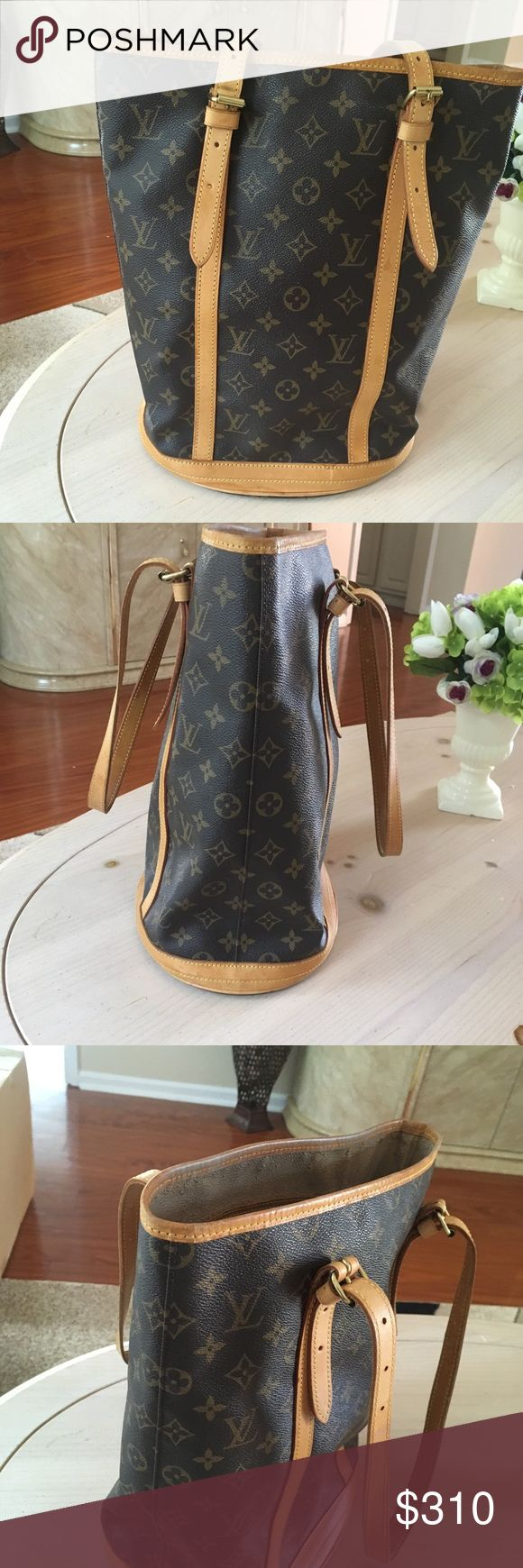 💯% Authentic lv large bucket bag Beautiful bag. Outside great condition. Inside starting to peel and sticky, not too bad. Normal wear, scratches, rubbing. Measures approximately 13.5 x 10.5 x 8 inch. Made in France. Louis Vuitton Bags Shoulder Bags