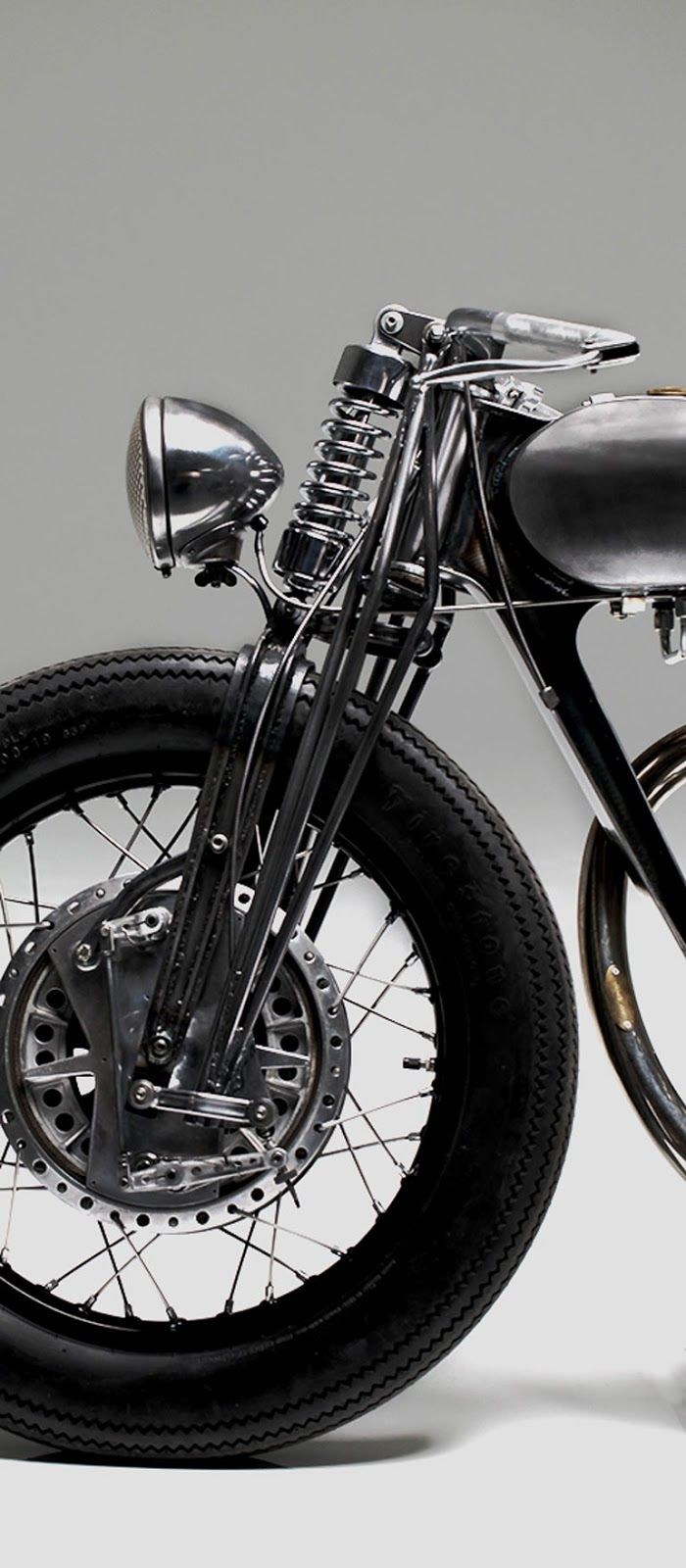 Old school design, - Girder front forks and drum brake can still be found today.