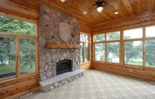 3 seasons room with fireplace...I am thinking this is a beautiful idea!