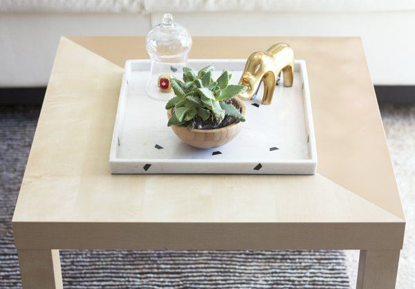 This coffee table is the perfect example of how versatile Ikea furniture is. With spray paint and painter's...