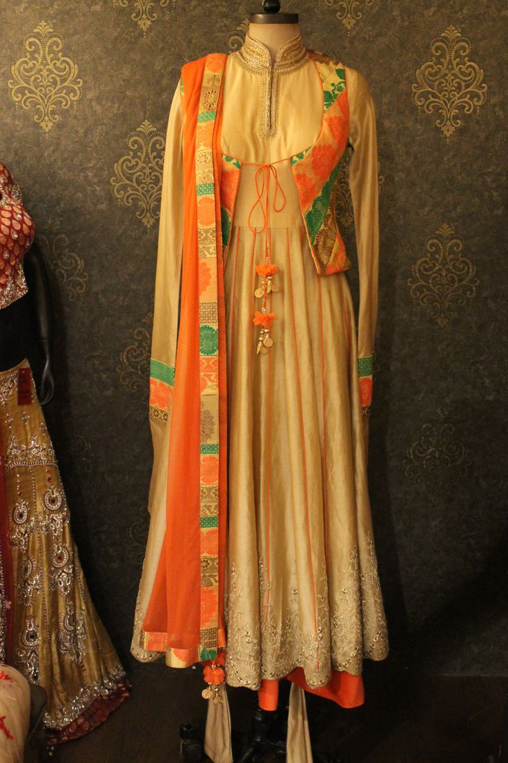 Gold Anarkali with orange b green brocade jacket can be worn with or without