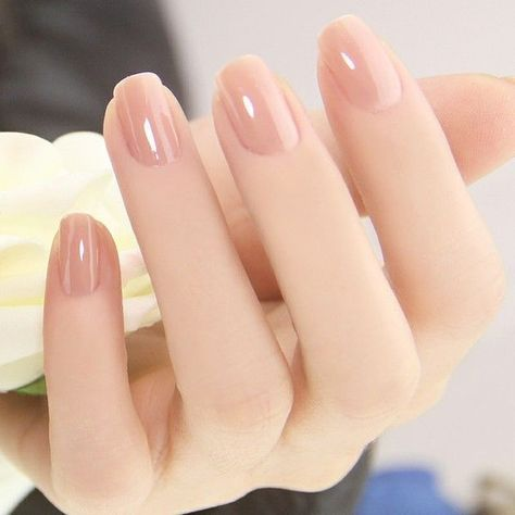 A glossy and perfect looking nude nail art. This type of nude polish makes the s…