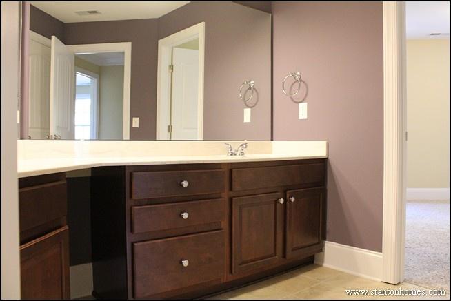 Dark brown cabinets in a purple bathroom new home design for Dark purple bathroom ideas