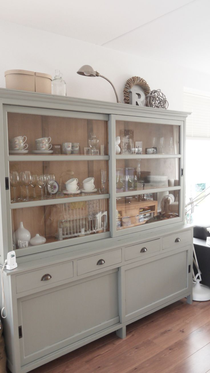 I adore this dresser - the sliding glass doors will keep the contents dust-free