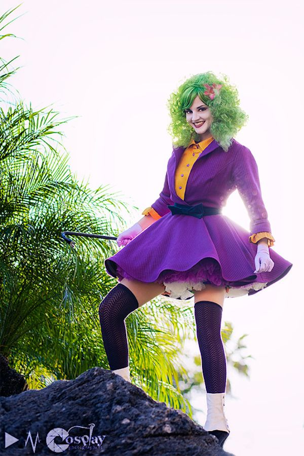 """Cosplayer Callesto all dolled up in a mini-skirted version of Joker's outfit based on his look in Arkham Asylum."""