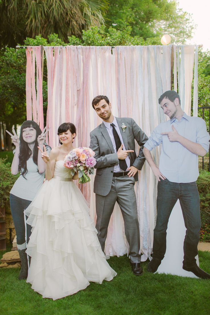 from Popsugar. Bridge and Groom had cardboard figures of themselves for photo booth. Cute