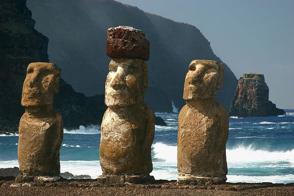 Easter Island, Chile. Easter Island...2000 inhabitants, early settlers carved over 900 statues called moai (only 3 shown here with a zoom lens), the settlers also began cutting down the islands trees and shrubs leaving the island hauntingly empty.