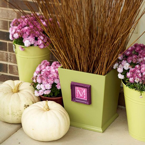 Monogrammed Planter     Make your house feel like a home with planters that call out your family's initial. This planter is actually a painted wooden trash can. The small frame, featuring a clip art letter, is attached with hot glue.