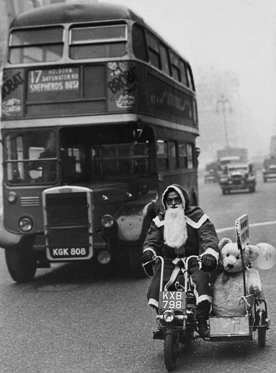 Santa Claus drives a motorcycle past a bus through Oxford Street, London. 1949. Photo: © Hulton-deutsch collection, Corbis.