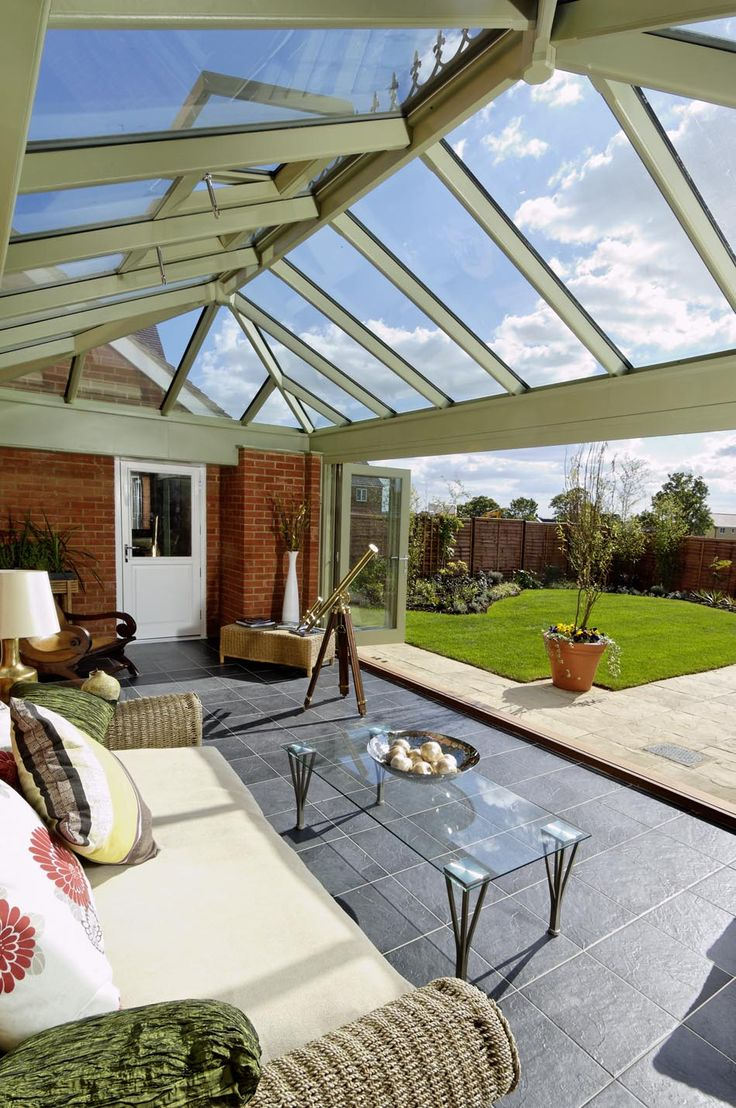 A Beautiful And Bright Hardwood Orangery With A Full Side Of Bi Folding  Doors By Moore