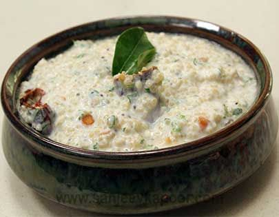 Dahi Quinoa  -Cooked quinoa mixed with yogurt, roasted peanuts and tempered South Indian style and chilled.