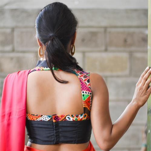 DESCRIPTION: This sultry piece in black, cocktail ready with a netted Kutchwork yoke atop a black Raw Silk body with a solid black high neck collar.FABRIC:Body - Black raw silkCollar - Black raw silkYoke - Black net with multicolour kutch threadworkPRODUCT CODE: HOB-MR15-SH-01CARE: Dryclean only