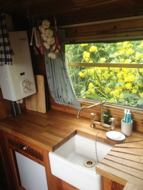 Narrowboat kitchen | Reclaimed Wood Kitchens & Furniture. Look at the carved-into-the-bunker-drainer. It's awesome :-)